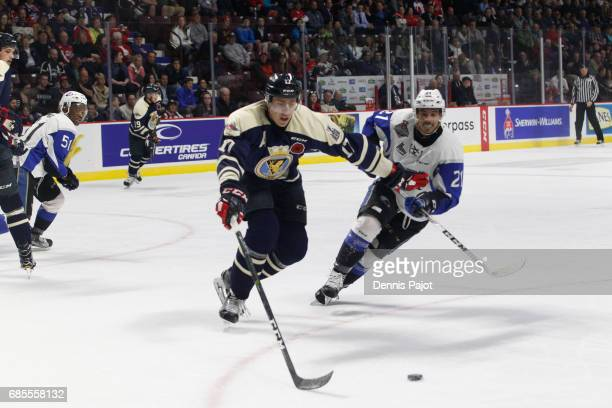 Forward Mathieu Joseph of the Saint John Sea Dogs skates against defenceman Logan Stanley of the Windsor Spitfires on May 19 2017 during Game 1 of...