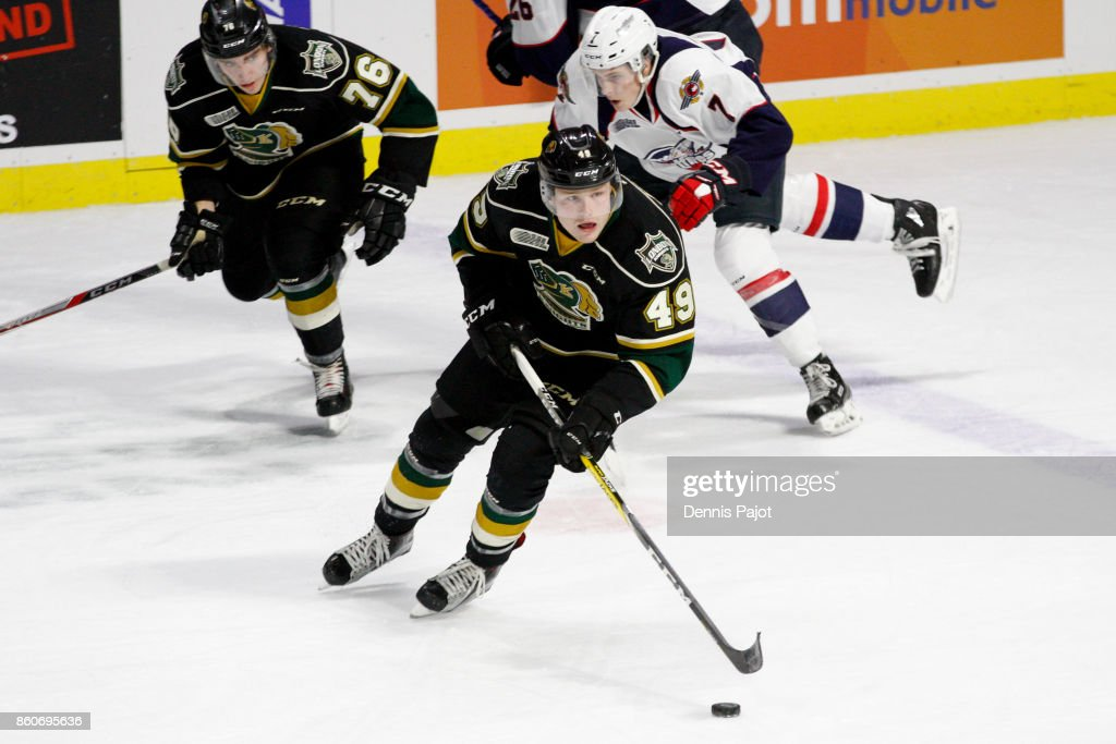 Forward Max Jones #49 of the London Knights moves the puck against the Windsor Spitfires on October 12, 2017 at the WFCU Centre in Windsor, Ontario, Canada.