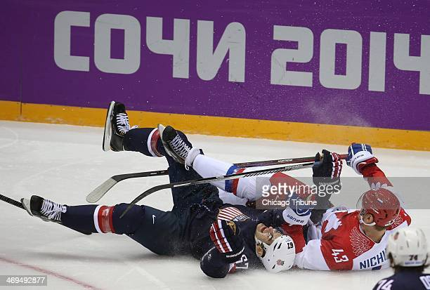 USA forward Max Pacioretty and Russia forward Valeri Nichushkin fall in the second period of a men's hockey game at Bolshoy Ice Dome during the...