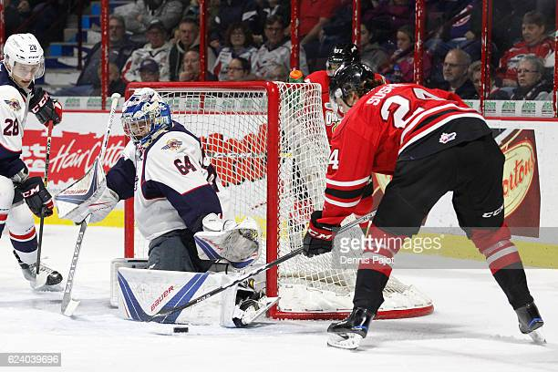 Forward Maxim Sushko of the Owen Sound Attack moves the puck against goaltender Michael DiPietro of the Windsor Spitfires on November 17 2016 at the...