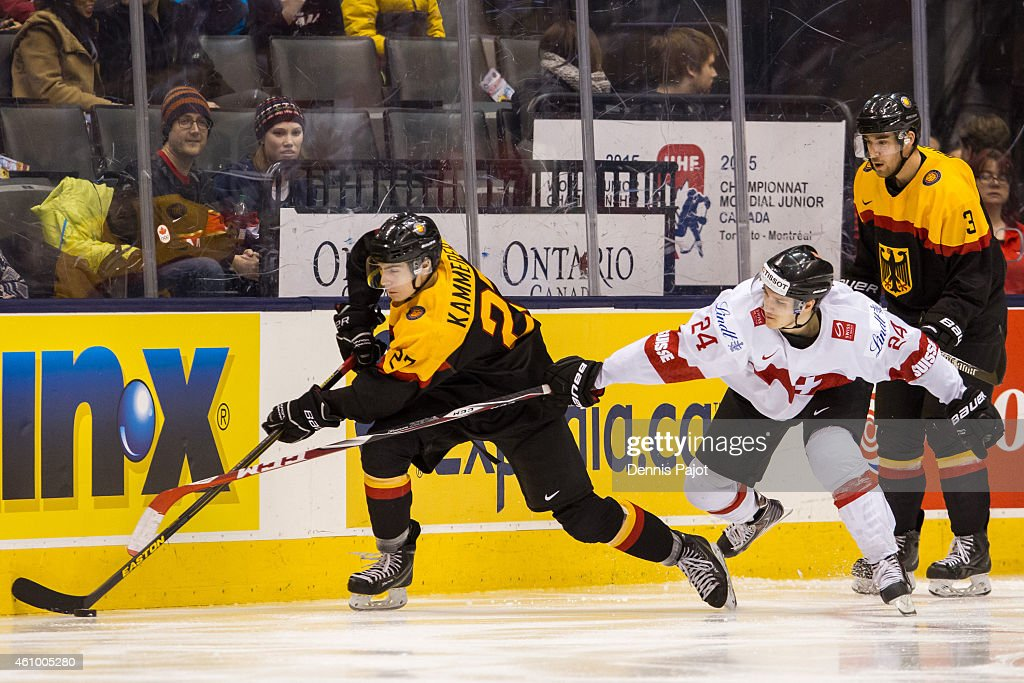 Forward Maximillian Kammerer #27 of Germany moves the puck against forward Pius Suter #24 of Switzerland during the 2015 IIHF World Junior Championship on January 03, 2015 at the Air Canada Centre in Toronto, Ontario, Canada.