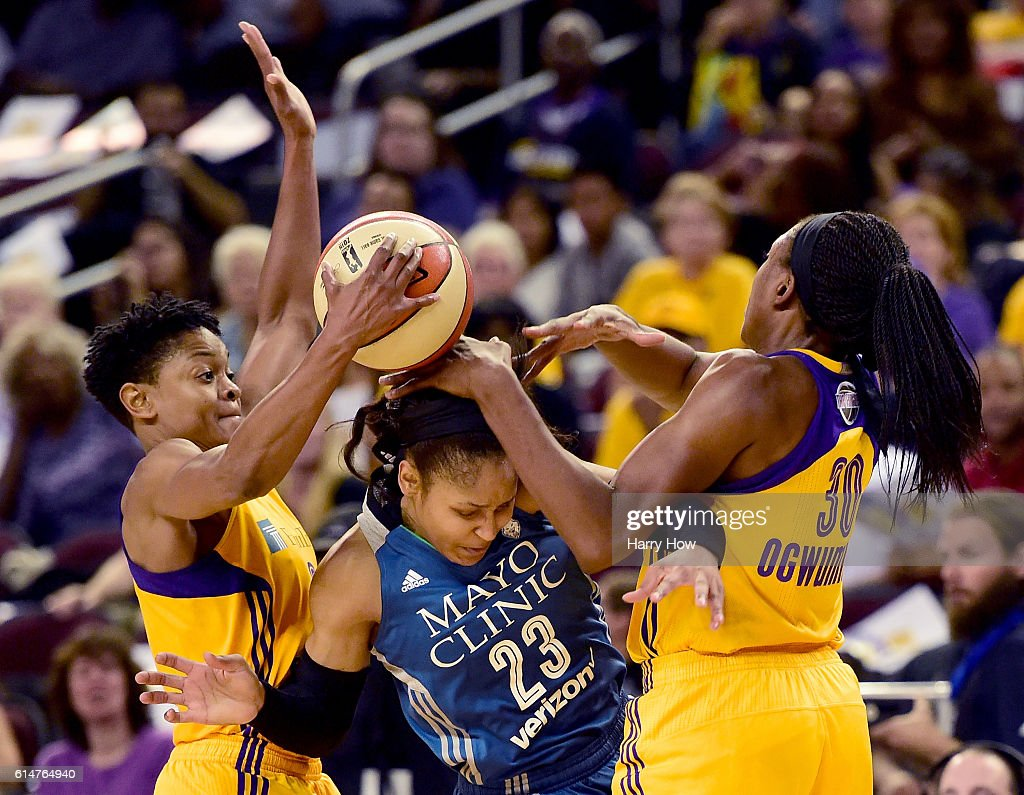 Forward Maya Moore #23 of the Minnesota Lynx gets trapped by guard Alana Beard #0 and forward Nneka Ogwumike #30 of the Los Angeles Sparks in game three of the 2016 WNBA Finals at Galen Center on October 14, 2016 in Los Angeles, California.