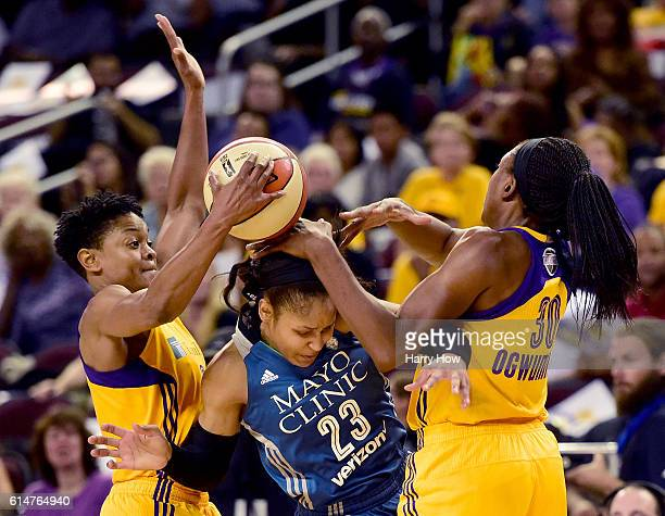 Forward Maya Moore of the Minnesota Lynx gets trapped by guard Alana Beard and forward Nneka Ogwumike of the Los Angeles Sparks in game three of the...