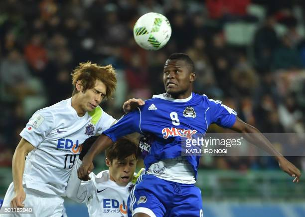 Forward Mbwana Samatta from Congolese side Mazembe fights for the ball with Japan's Sanfrecce Hiroshima defender Sho Sasaki during their Club World...