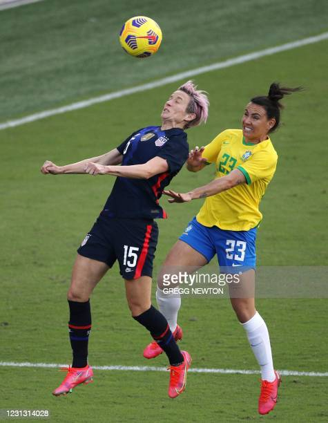 Forward Megan Rapinoe is challenged by defender Jucinarao of Brazil during their SheBelieves Cup international soccer tournament game at Exploria...