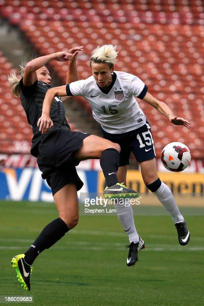 Forward Megan Rapinoe of the of the US Women's National Team battles for the ball with forward Hannah Wilinson of New Zealand during the first half...