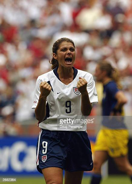 Forward Mia Hamm of the United States celebrates during the 2003 FIFA Women's World Cup first round Group A game against Sweden at RFK Stadium on...