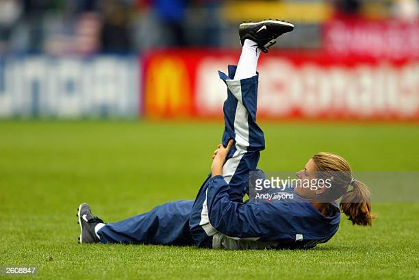 Forward Mia Hamm of the United States stretches during halftime in the 2003 FIFA Women's World Cup against North Korea at Crew Stadium on September...