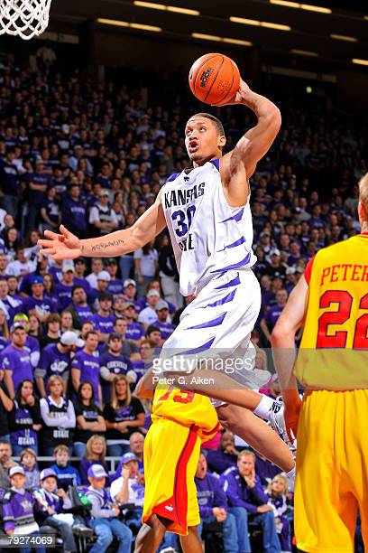 Forward Michael Beasley of the Kansas State Wildcats drives to the basket in the second half against the Iowa State Cyclones during an NCAA...