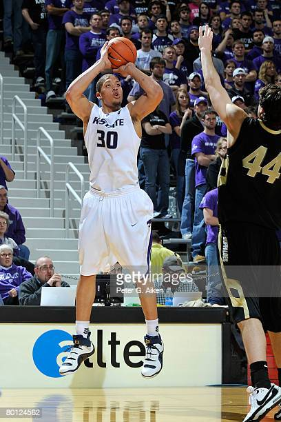Forward Michael Beasley of the Kansas State Wildcats hits a 3point shot over Colorado Buffaloes forward Trent Beckley in the second half of an NCAA...