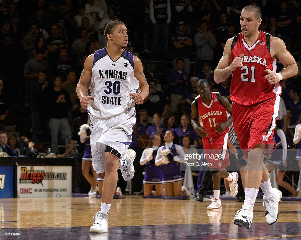 Forward Michael Beasley #30 of the Kansas State Wildcats runs down the court with center Aleks Maric #21 of the Nebraska Cornhuskers in the first half of an NCAA Basketball game on February 6, 2008 at Bramlage Coliseum in Manhattan, Kansas. Kansas State defeated Nebraska 74-59.