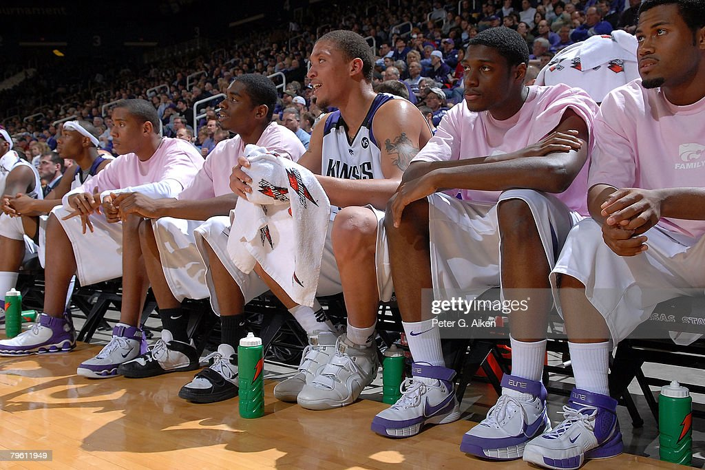Forward Michael Beasley (C) of the Kansas State Wildcats sits on the bench with his teammates in the second half against the Nebraska Cornhuskers during a NCAA Basketball game on February 6, 2008 at Bramlage Coliseum in Manhattan, Kansas. Kansas State defeated Nebraska 74-59.