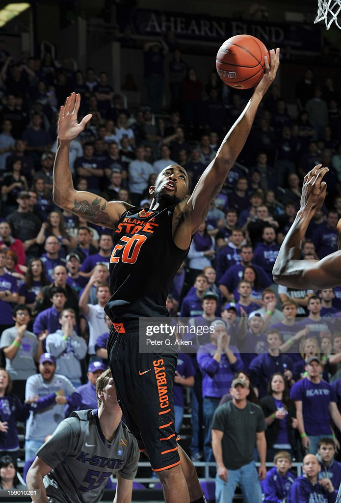Forward Michael Cobbins #20 of the Oklahoma State Cowboys drives to the basket against the Kansas State Wildcats during the first half on January 5, 2013 at Bramlage Coliseum in Manhattan, Kansas. Kansas State defeated Oklahoma State 73-67.