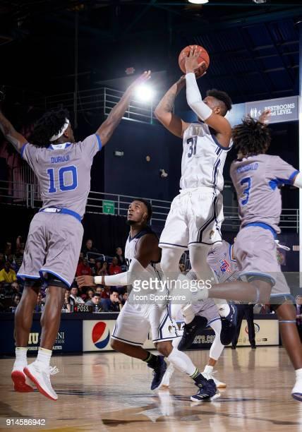FIU forward Michael Douglas shoots during a college basketball game between the Louisiana Tech University Bulldogs and the Florida International...