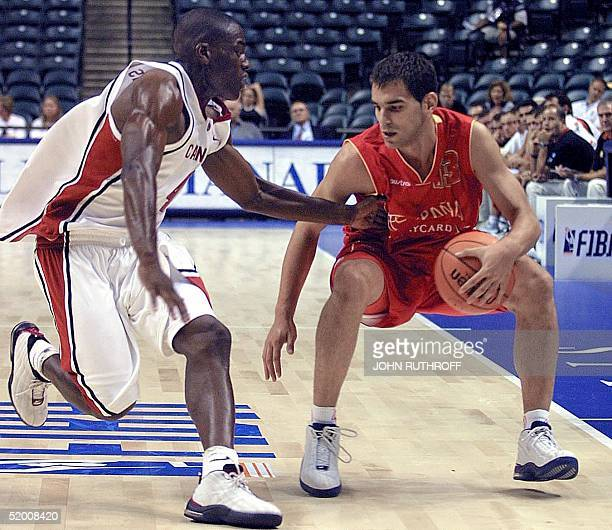 Forward Michael Meeks of Canada defends against guard Jose Manuel Calderon of Spain during the 2002 FIBA World Basketball Championship at the Conseco...