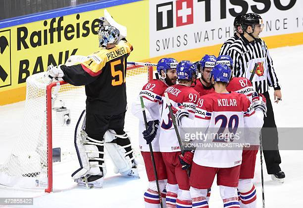 Forward Michal Vondrka of Czech Republic celebrates with his teammates after scoring a goal during the group A preliminary round match Germany vs...