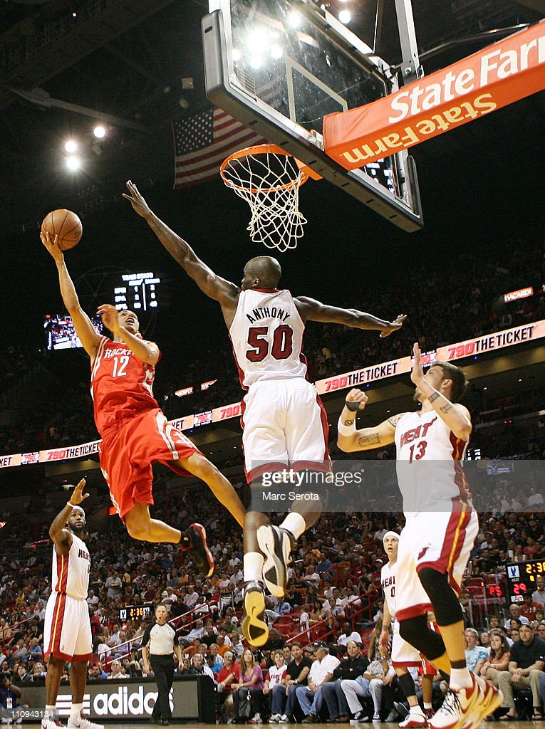 Forward Mike Miller #13 (R) and Joel Anthony #50 of the Miami Heat defend against gurad Kevin Martin #12 of the Houston Rockets at American Airlines Arena on March 27, 2011 in Miami, Florida.