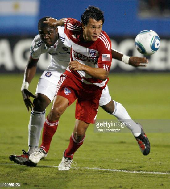 Forward Milton Rodriguez of FC Dallas beats out defender Kwame WatsonSiriboe of the Chicago Fire to score at Pizza Hut Park on October 2 2010 in...