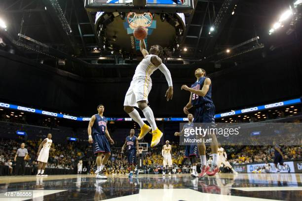 Forward Mo Alie-Cox of the VCU Rams dunks the ball against the Richmond Spiders in the Quarterfinals of the men's Atlantic 10 tournament on March 14,...