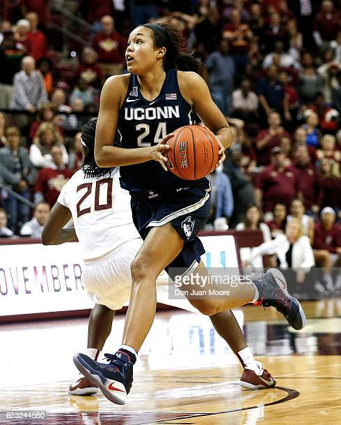 Forward Napheesa Collier of the Connecticut Huskies drives to the basket against Forward Shakayla Thomas of the Florida State Seminoles during the...