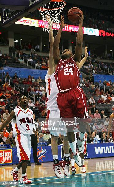 Forward Nate Carter of the Oklahoma Sooners drives the hoop against the Iowa State Cyclones during the first round of the Phillips Big 12 Men's...