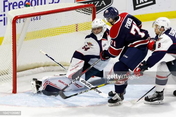 Forward Nicholas Porco of the Saginaw Spirit fires a first period goal against goaltender Michael DiPietro of the Windsor Spitfires on September 27...
