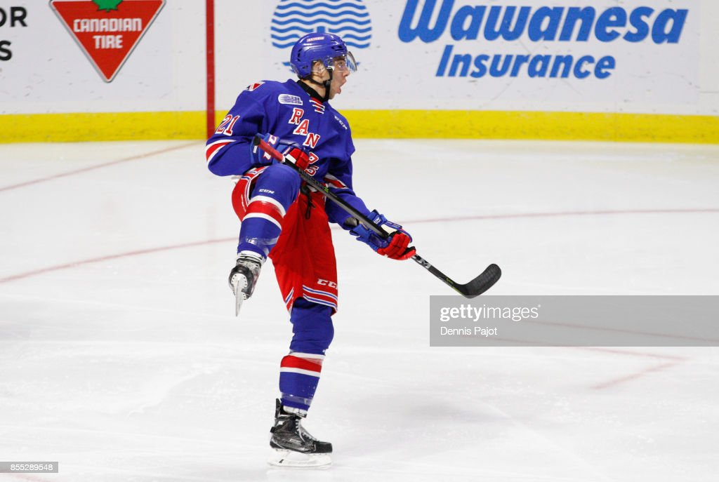 Forward Nick McHugh #21 of the Kitchener Rangers celebrates his first period goal against the Windsor Spitfires on September 28, 2017 at the WFCU Centre in Windsor, Ontario, Canada.