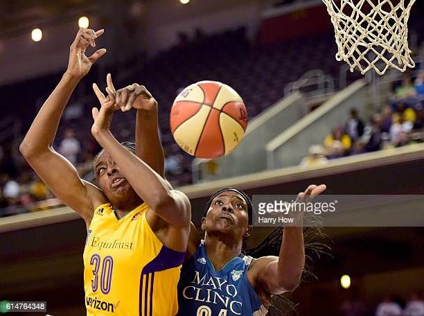 Forward Nneka Ogwumike of the Los Angeles Sparks and center Sylvia Fowles of the Minnesota Lynx battle for a rebound in game three of the 2016 WNBA...