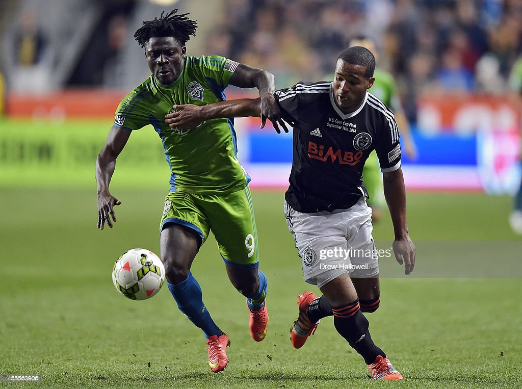 Forward Obafemi Martins #9 of the Seattle Sounders FC and defender Ethan White #15 of the Philadelphia Union race for the ball during the 2014 U.S. Open Cup Final at PPL Park on September 16, 2014 in Chester, Pennsylvania. The Sounders won 3-1.