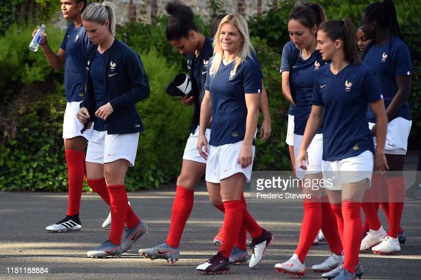 Forward of France women's football team Eugenie Le Sommer arrives for a official photo during the official presentation at the French training center...