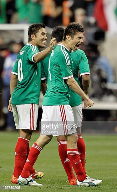 Forward Oribe Peralta of Mexico celebrates with Marcos Fabian after scoring against Venezuela in the 90th minute during the international friendly...