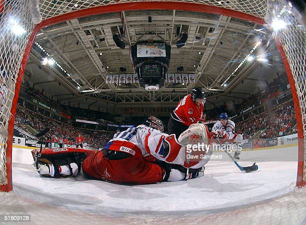 Forward Patrice Bergeron of Canada fires a backhand shot past Marek Schwarz of the Czech Republic during the semifinal game of the World Junior...