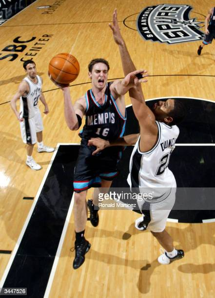 Forward Pau Gasol of the Memphis Grizzlies drives toward the hoop while defended by Tim Duncan of the San Antonio Spurs in game two of the first...