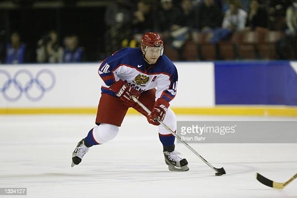 Forward Pavel Bure of Russia skates with the puck against Belarus during the mens ice hockey bronze medal game on February 23 2002 at the Salt Lake...