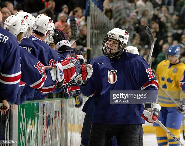 Forward Phil Kessel of Team USA is congratulated by teammates after scoring against Sweden during their quarterfinal game at the World Junior Hockey...