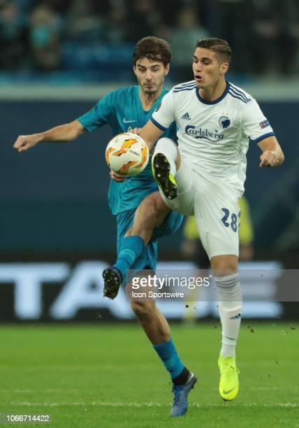 forward Pieros Sotiriou of FC Kopenhagen in action with midfielder Aleksandr Erokhin of FC Zenit during UEFA Europe League Group Stage Group C match...