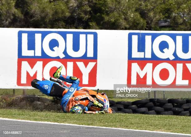 Forward Racing Team's Italian rider Lorenzo Baldassari crashes during the Australian Grand Prix Moto2 race at Phillip Island circuit on October 28...