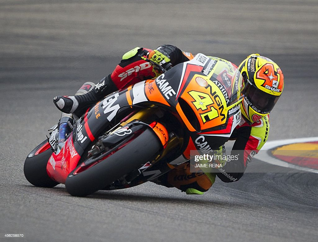 NGM Forward Racing's Spanish rider Aleix Espargaro competes in the MotoGP race Aragon Grand Prix at the Motorland racetrack in Alcaniz on September 28, 2014.