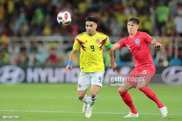 forward Radamel Falcao of Colombia National team and defender John Stones of England National team during the round of 16 match between Colombia and...