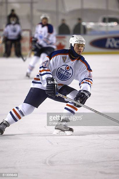 Forward Raffi Torres of the Edmonton Oilers skates on the ice during the game against the Montreal Canadiens at the Molson Canadien Heritage Classic...