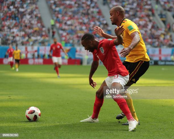 Forward Raheem Sterling of England National team defender Vincent Kompany of Belgium National team during the third place match between Belgium and...