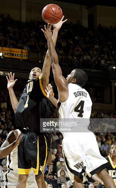 Forward Renardo Dixon tries to block a left-handed floater by Wake Forest guard Taron Downey during the first half of the Demon Deacons 81-67 victory...