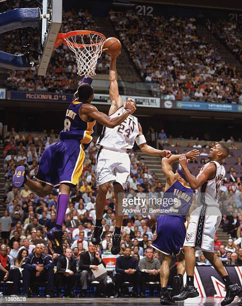 Forward Richard Jefferson of the New Jersey Nets dunks over guard Kobe Bryant of the Los Angeles Lakers during Game Four of the 2002 NBA Finals at...
