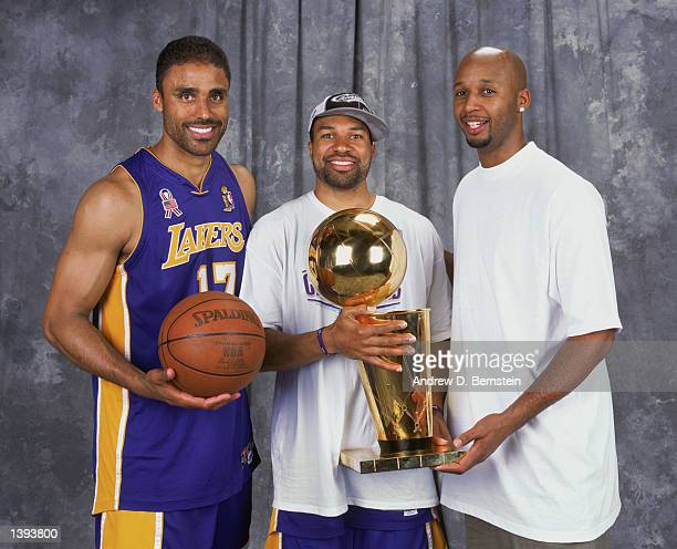 Forward Rick Fox point guard Derek Fisher and Brian Shaw of the Los Angeles Lakers stand with the trophy after winning Game Four of the 2002 NBA...