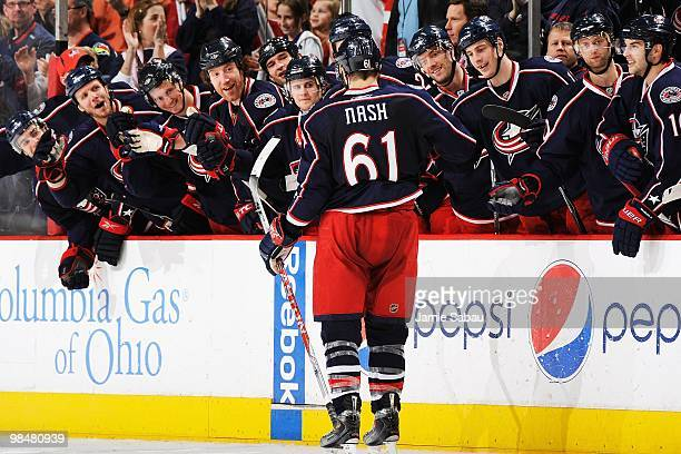 Forward Rick Nash of the Columbus Blue Jackets is congratulated by his teammates after scoring a shoot out goal against the Detroit Red Wings on...