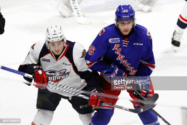 Forward Rickard Hugg of the Kitchener Rangers battles on a faceoff against Forward Tyler Angle of the Windsor Spitfires on September 28 2017 at the...