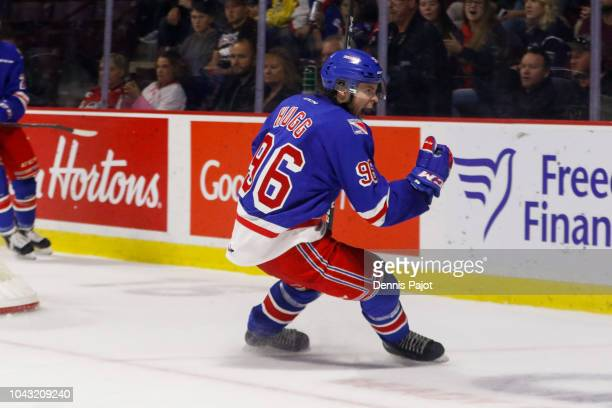 Forward Rickard Hugg of the Kitchener Rangers celebrates his empty net third perioad goal against the Windsor Spitfires on September 29 2018 at the...