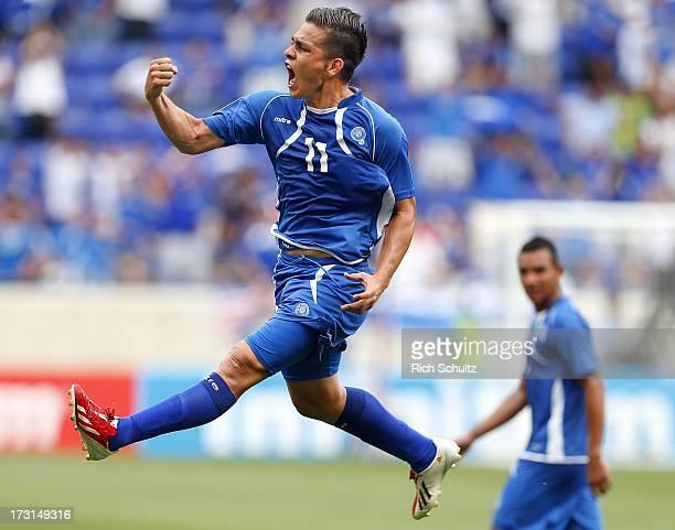 Forward Rodolfo Zelaya of El Salvador celebrates his first half goal off a penalty kick against Trinidad and Tobago in a 2013 CONCACAF Gold Cup...