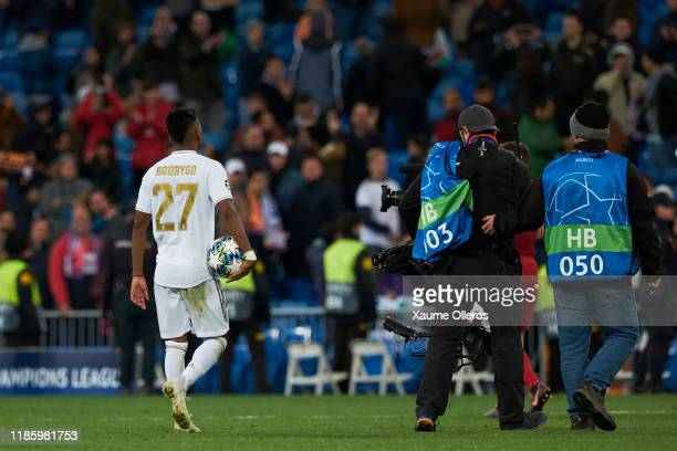 Forward Rodrygo of Real Madrid CF leaves the pitch with the ball after scoring a hat trick during the UEFA Champions League group A match between...