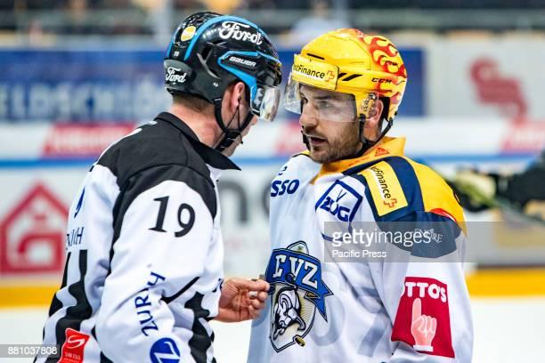 RESEGA LUGANO TICINO SWITZERLAND Forward Roe Garret of EV Zug talk to linesman Nicolas Fluri during the NLA Swiss League match HC LuganoEv Zug